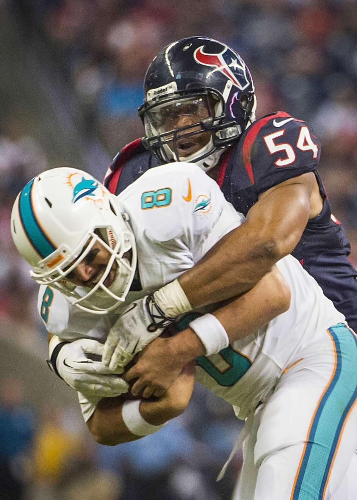 Texans linebacker Trevardo Williams sacks Dolphins quarterback Matt Moore.