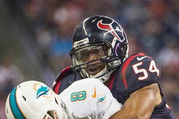 Texans linebacker Trevardo Williams sacks Dolphins quarterback Matt Moore.