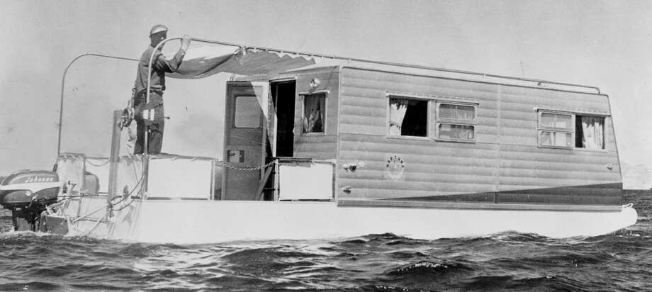 Wheels retract when houseboat Neptuna takes to water. April 29, 1956.