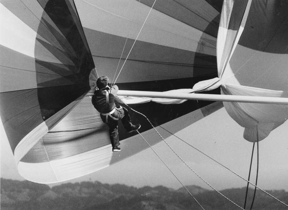 "Crew member of ""Tomahawk"" does a quick change of the spinnaker poler. October 1, 1986. Photo: Eric Luse, The Chronicle"