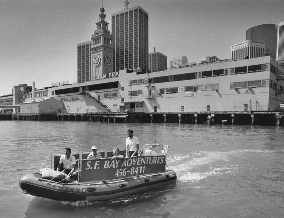 Inflatable boat operated by S.F. Bay Adventures tours the waterfront near the Ferry Building. May 6, 1987. Photo: Jerry Telfer, The Chronicle