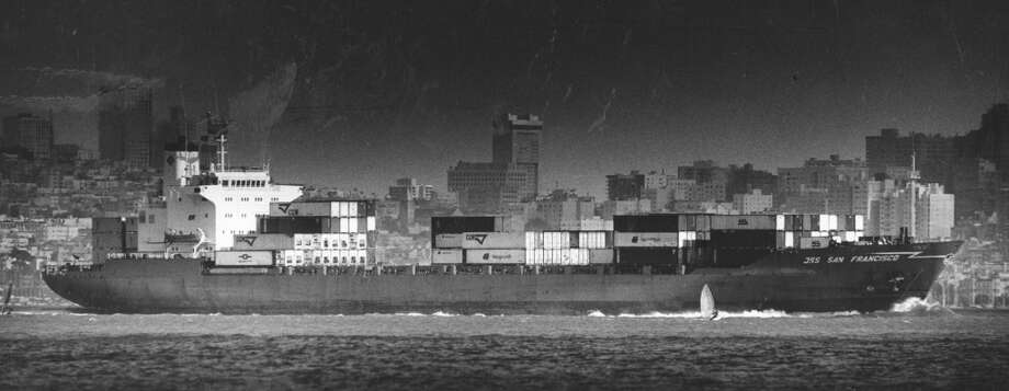 A windsurfer races alongside a container ship bound for the ocean, heading out of the Golden Gate. June 15, 1987. Photo: Tom Levy, The Chronicle