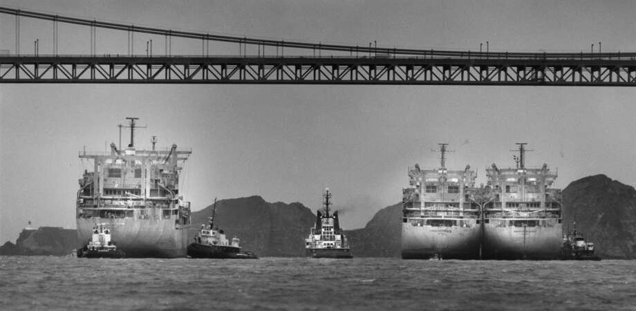 "Three 8,500 ton cargo ships, the ""American Monarch,"" the ""American Titan"" and ""American Spitfire,"" wait to be towed by the Dutch tugboat, ""Smit London"" to Taiwan to be turned into scrap metal. July 19, 1991. Photo: Vince Maggiora, The Chronicle"
