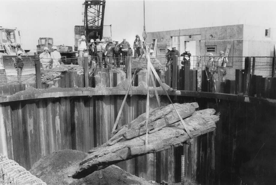 An historic shipwreck fragment is reburied in the hole it was found during sewer construction work along the Great Highway near Sloat Blvd. The reburial was meant to preserve the fragment, which was thought to be a piece from the bow of the Patrician — a ship wrecked in 1873. May 27, 1993. Photo: Michael Maloney, The Chronicle
