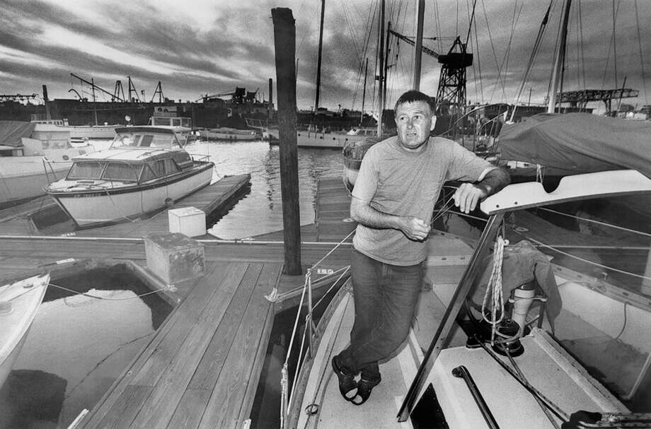 John Hepplewhite aboard his sailboat, docked at a marina along the Oakland Estuary. He lived on the boat illegally to save money. Photo taken at the Oakland Estuary, March 22, 1993. Photo: Michael Macor, The Chronicle