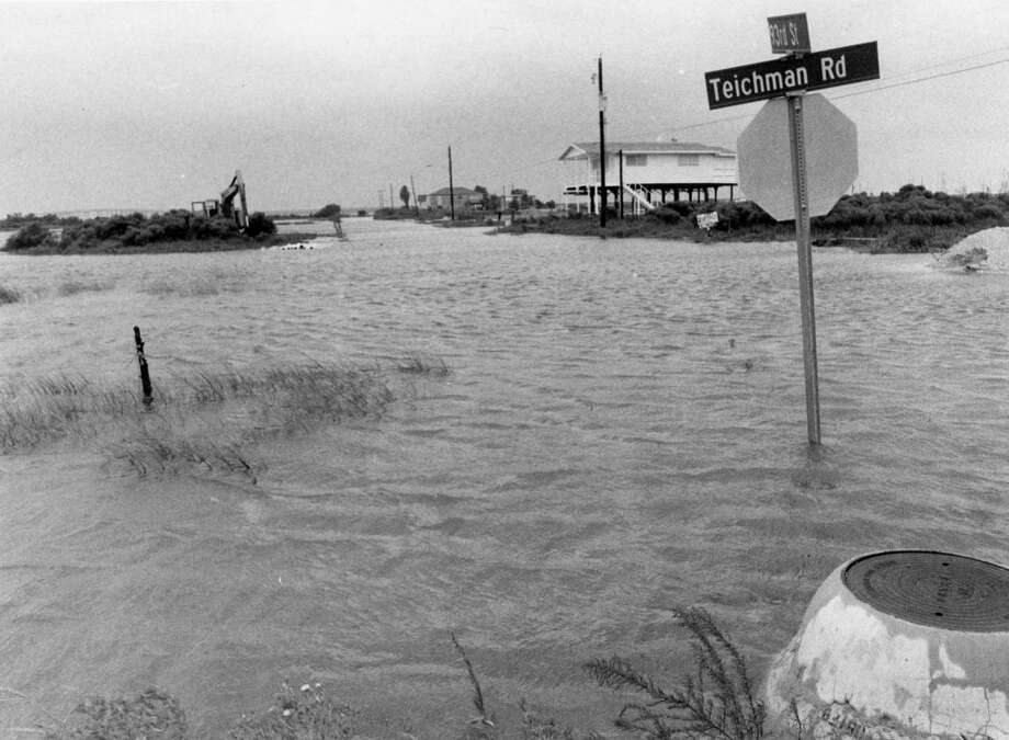 From the August 18, 1983, Houston Chronicle: Teichman Road at 93rd Street on the low-lying north side of Galveston Island is flooded by high tides as Hurricane Alicia heads toward the upper Texas coast. Photo: John Van Beekum, Houston Chronicle