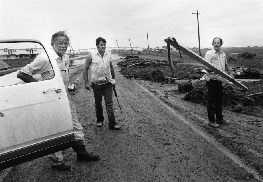 John Tarter Jr., left, John Tarter III and Doug Sanders with snake along the Texas Coast following Hurricane Alicia, August 18, 1983. Photo: Cathy Ambrose Smith, Houston Post