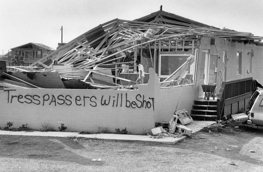 Grim sign at Jamaica Beach on hardware store that opened only six weeks earlier, August 21, 1983. Photo: Craig Hartley, Houston Post