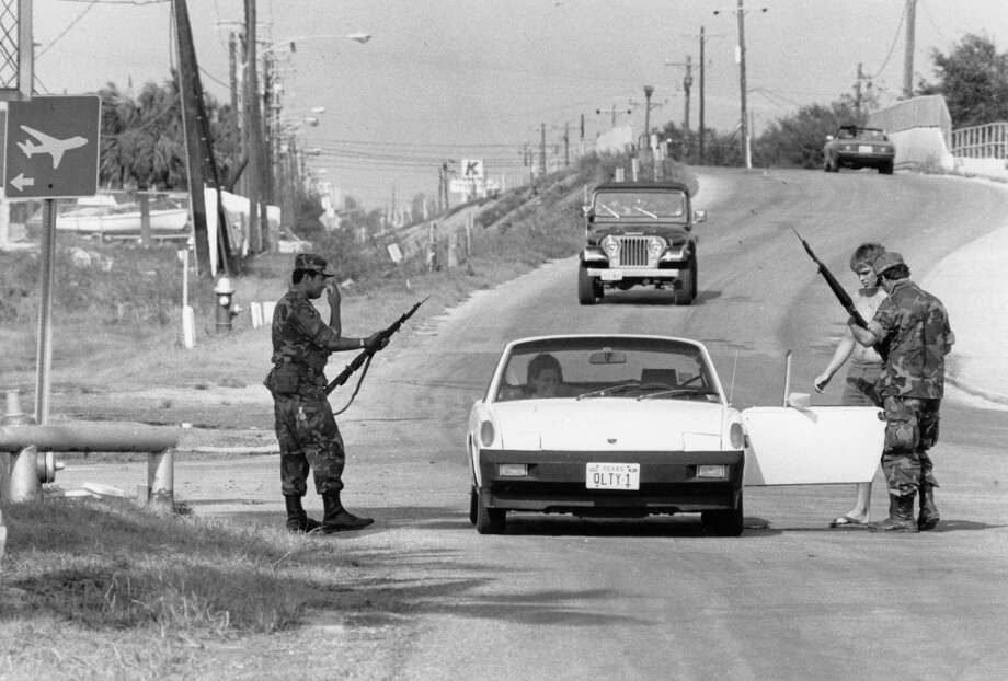 National Guardsmen stop traffic and check IDs before letting people in Galveston airport after Hurricane Alicia, August 2, 1983. Photo: Craig Hartley, Houston Post