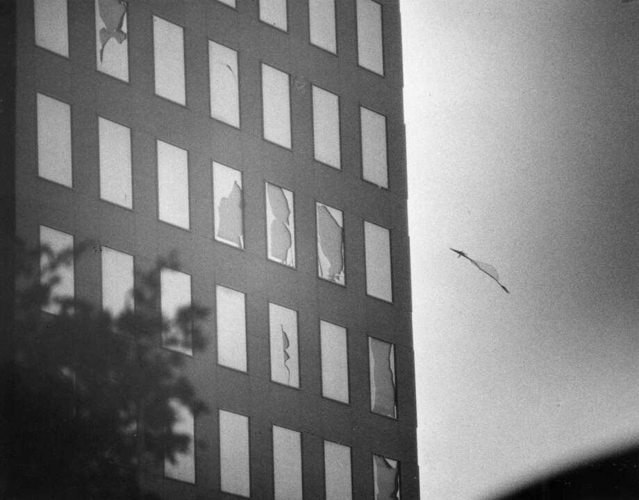 A pane of window glass hurtles off of the Inter-First Bank Building in the downtown area during the peak of Hurricane Alicia, August 1983. Photo: E. Joseph Deering, Houston Chronicle