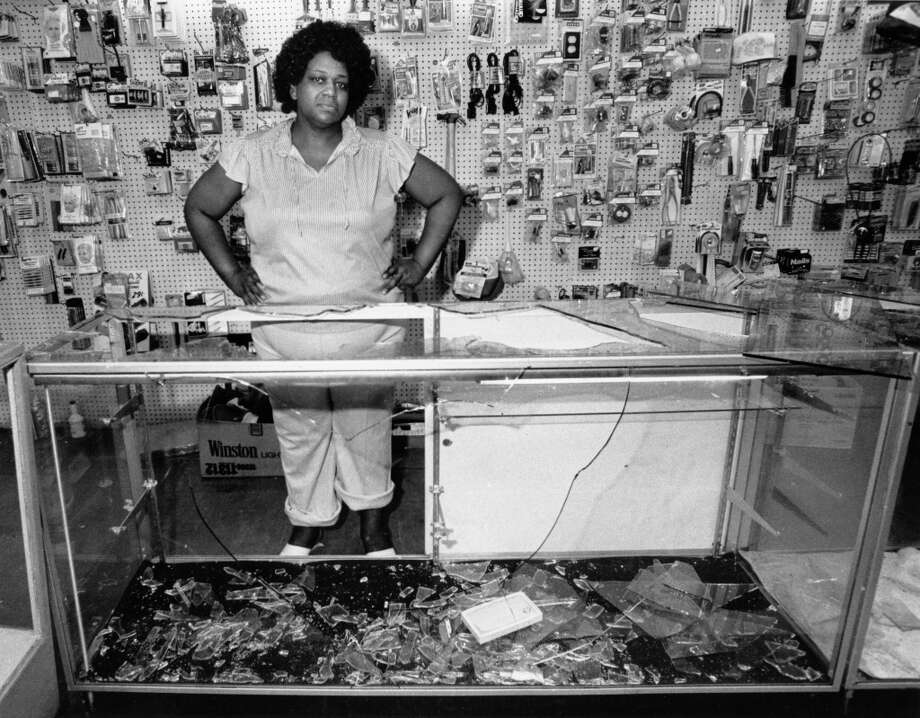 Alma Hall surveys broken counters at Ralston's after gang looting in wake of Hurricane Alicia, August 19, 1983. Photo: Audrey Ueckert, Houston Post