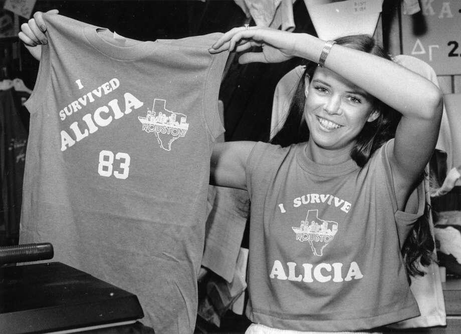 Street Smart shop manager Denise Tatum shows off Hurricane Alicia apparel, August 20, 1983. Photo: Sandra Shriver, Houston Post