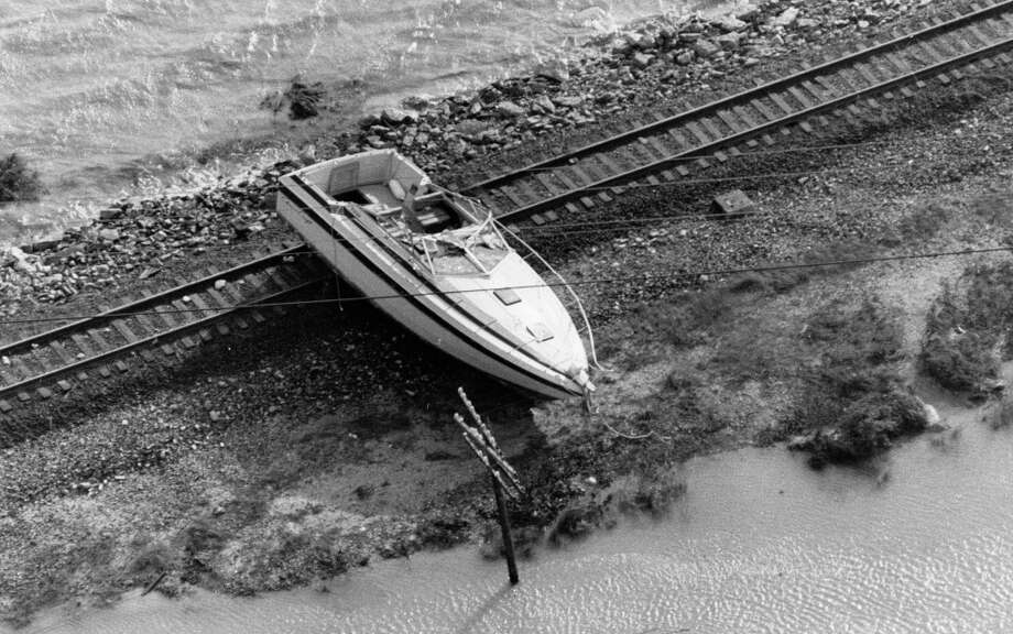 Boat on railroad track north of Galveston, near Gulf Freeway, August 18, 1983. Photo: Craig Hartley, Houston Post