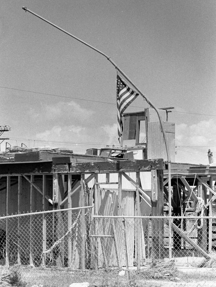West Beach. The house is gone, the pole's bent, but Old Glory is still flying, August 31, 1983. Photo: Joel Draut, Houston Post