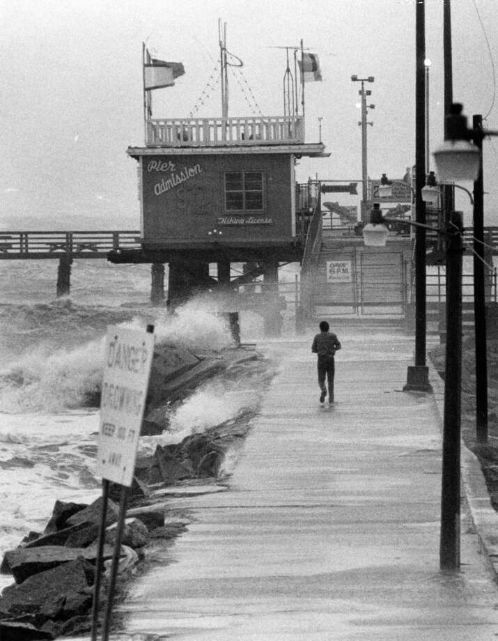 Waves lash fishing pier in Galveston, August 18, 1983. Photo: Fred Bunch, Houston Post