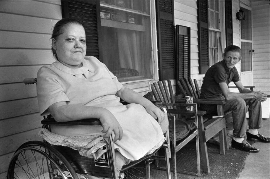 From the August 21, 1983, Houston Chronicle: Linda and R.L. Musgrove, both of whom are disabled, returned home after riding out Hurricane Alicia at a friend's house to find that looters had stolen most of their possessions. Photo: Steve Ueckert, Houston Chronicle