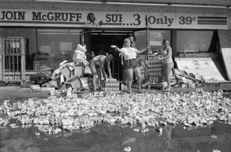 From the August 28, 1983, Houston Chronicle: Employees at a 7-Eleven in Surfside were kept busy destroying about 800 cases of beer the Texas Department of Health said had been contaminated during Hurricane Alicia. Store manager Loyce Cox said each can would have needed to be checked for external contamination, a process that would have been more expensive that dumping the beer, worth $10,000. Another $76,000 worth of merchandise also was discarded. The store was damaged extensively by the storm and will not reopen until next spring, but employees will be relocated within the 7-Eleven organization. Photo: John Toth, Houston Chronicle