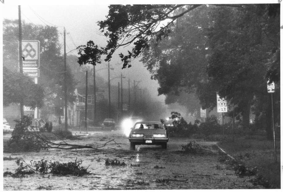 Debris-strewn Houston streets were only a small part of the damage Hurricane Alicia left when it swept through in August 1983. Photo: Darrell Davidson, Houston Chronicle