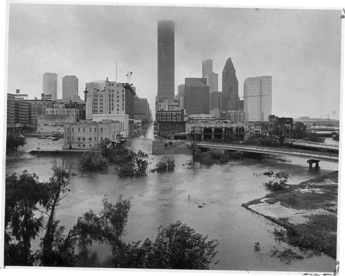 In 1983, Allen's Landing, Buffalo Bayou and the north end of downtown Houston are flooded in the aftermath of Hurricane Alicia.