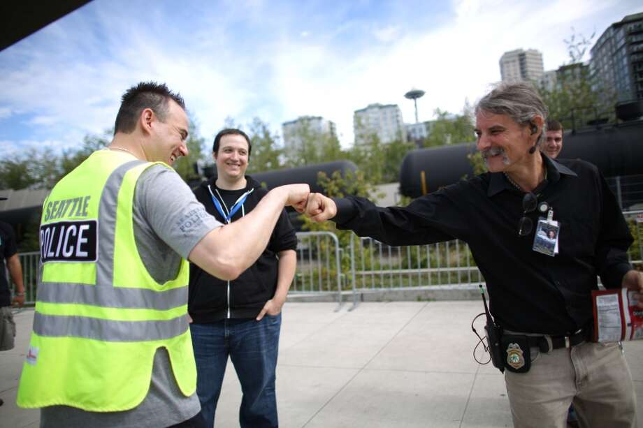 Seattle Police Sgt. Sean Whitcomb is thanked by  Vivian McPeak, Hempfest executive director after police passed out bags of Doritos affixed with a sticker that helps spell out rules for marijuana users during the second day of Seattle's annual Hempfest. This is the first year for the annual pro-pot rally since Washington State voters legalized recreational use of marijuana. Photographed on Saturday, August 17, 2013. Photo: JOSHUA TRUJILLO, SEATTLEPI.COM