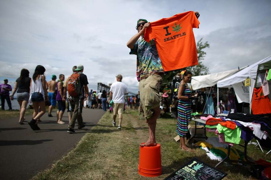 Reeve Petersen sells shirts during the second day of Seattle's annual Hempfest. This is the first year for the annual pro-pot rally since Washington State voters legalized recreational use of marijuana. Photographed on Saturday, August 17, 2013. Photo: JOSHUA TRUJILLO, SEATTLEPI.COM