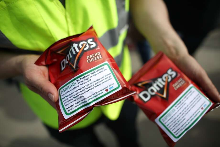Bags of Doritos are shown as Seattle Police public affairs officers hand out bags of the chips with a sticker affixed that helps spell out rules for marijuana users during the second day of Seattle's annual Hempfest. This is the first year for the annual pro-pot rally since Washington State voters legalized recreational use of marijuana. Photographed on Saturday, August 17, 2013. Photo: JOSHUA TRUJILLO, SEATTLEPI.COM