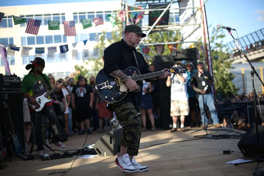 Musicians perform on the main stage during the second day of Seattle's annual Hempfest. This is the first year for the annual pro-pot rally since Washington State voters legalized recreational use of marijuana. Photographed on Saturday, August 17, 2013. Photo: JOSHUA TRUJILLO, SEATTLEPI.COM