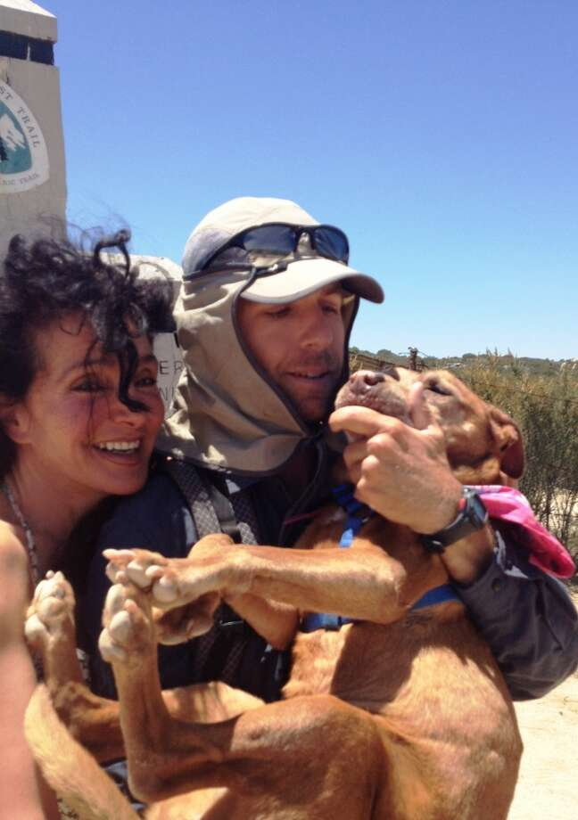 A family goodbye two months ago at California-Mexico border, Josh Garrett with Karen Dawn, and doggy Paula Photo: Tish Wood