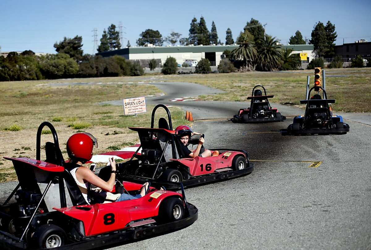 Go-karts race around the track at Malibu Grand Prix in Redwood City, Calif., Friday, August 16, 2013. The amusement center is closing its doors after 35 years of operation.