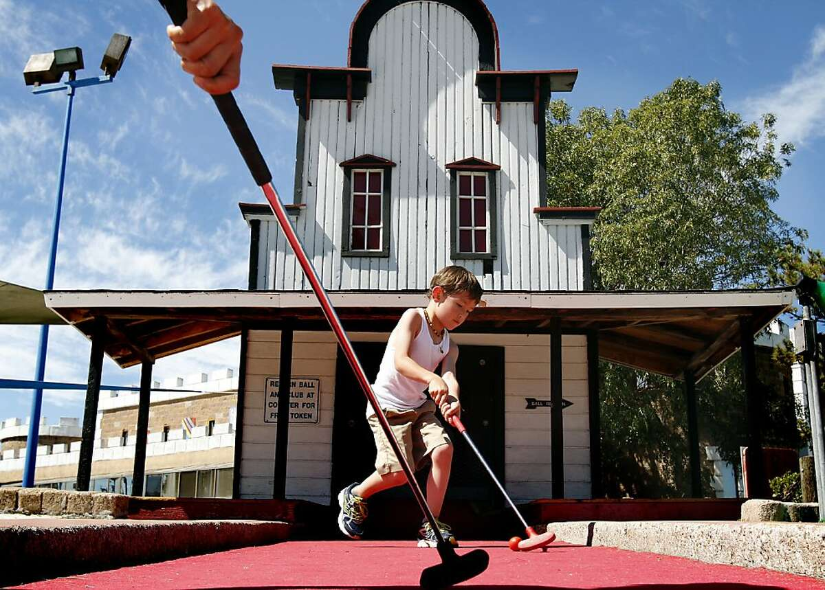 Niko Lukeziz, 5, of Brisbane, plays his final hole at Malibu Grand Prix in Redwood City, Calif., Friday, August 16, 2013. The amusement center is closing its doors after 35 years of operation.