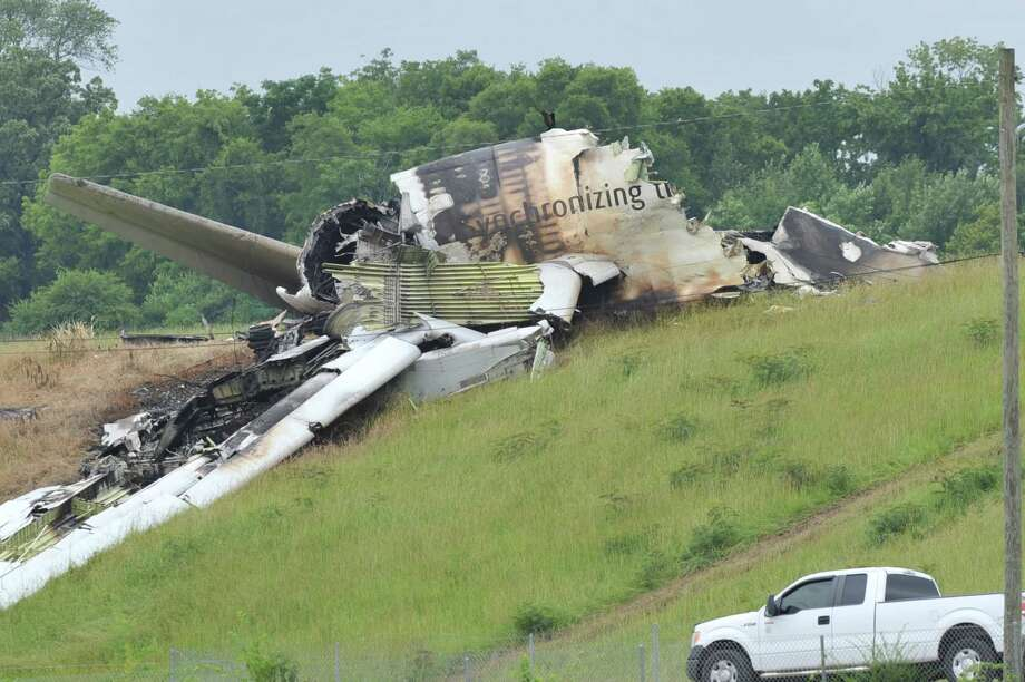 The National Transportation Safety Board and FBI scour the field north of the Birmingham-Shuttlesworth International Airport where UPS flight 1354 crashed on Wedesday, on Friday, Aug. 16, 2013 in Birmingham, Ala. Photo: AP