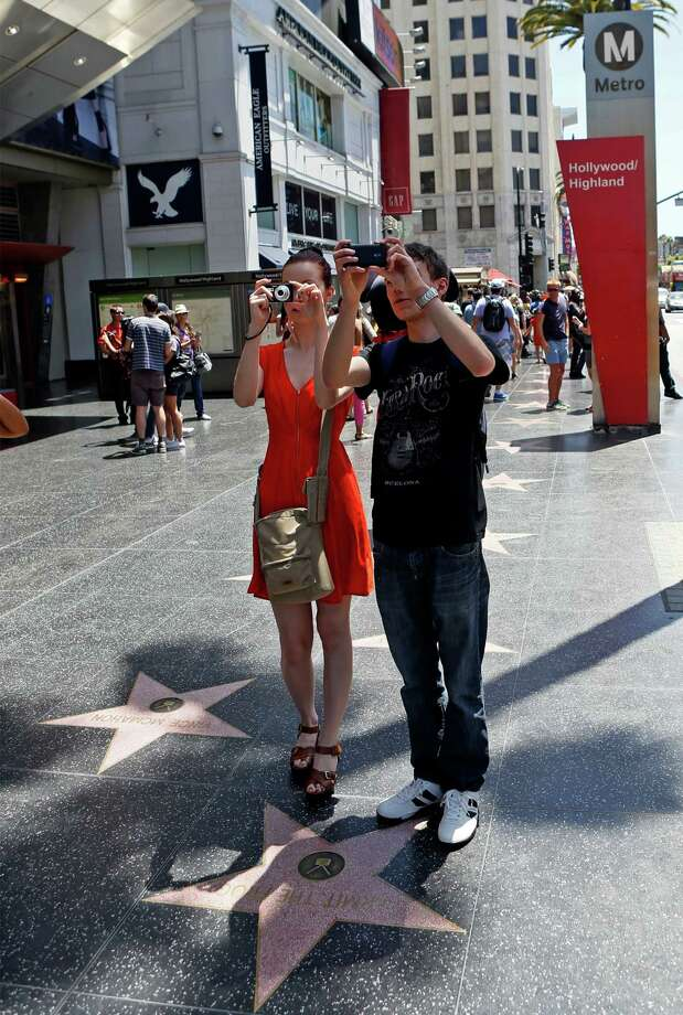 Austrian tourists take photos on the 'Hollywood Walk of Fame' in Los Angeles. A woman's fatal stabbing on Hollywood's Walk of Fame may have been prevented if there had not been several systemic failures in the Los Angeles County Probation Department, according to a report obtained by The Associated Press on Thursday, Aug. 15, 2013. Photo: AP