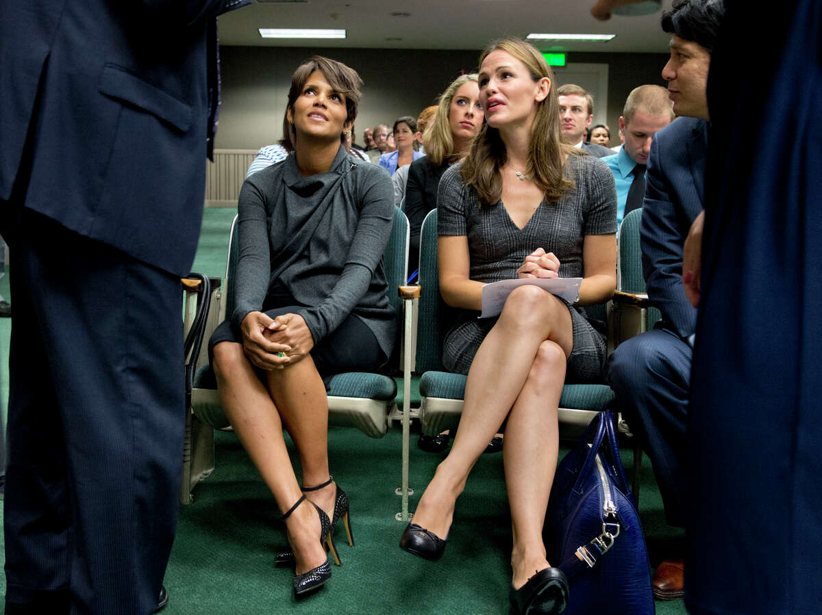 Actresses Halle Berry, left, and Jennifer Garner sit in the gallery before they testify at the state Capitol in Sacramento, Calif., on Tuesday, Aug. 13, 2013 in favor of a bill aimed at restricting paparazzi access to children. The stars testified before the Assembly Judiciary Committee regarding SB606, which would impose tougher penalties on photographers who harass celebrities and their children.