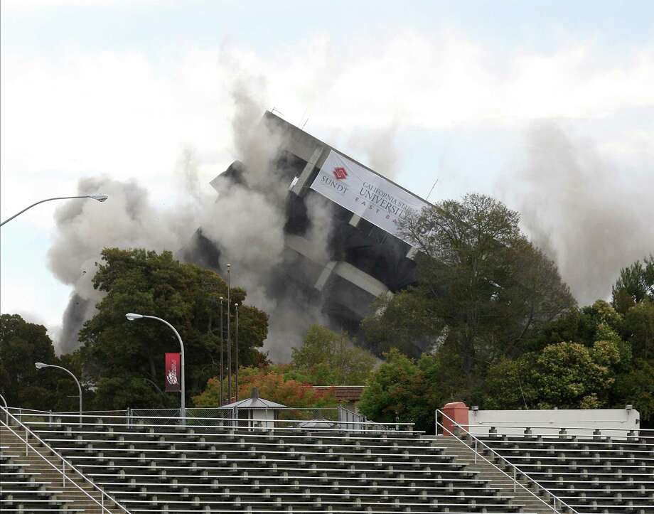 Warren Hall implodes on the campus of Cal State East Bay in Hayward, Calif., on Saturday, Aug. 17, 2013. The 13-story administration building has been vacant for two years after being declared seismically unsafe. Photo: AP