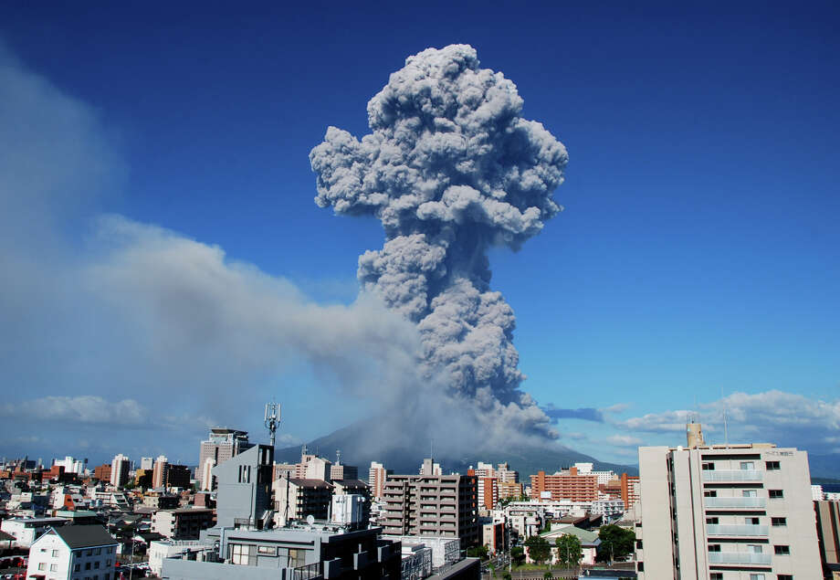 In this photo released by Kagoshima Local Meteorological Observatory, volcanic smoke billows from Mount Sakurajima in Kagoshima, on the southern Japanese main island of Kyushu Sunday, Aug. 18, 2013. Kyodo reported that it erupted Sunday evening, marking the 500th eruption this year at the 1,117 meters (3,686 foot) high mountain, which is one of Japan's most active volcanoes. There is no immediate reports of injuries.  (AP Photo/Kagoshima Local Meteorological Observatory)  Photo: AP