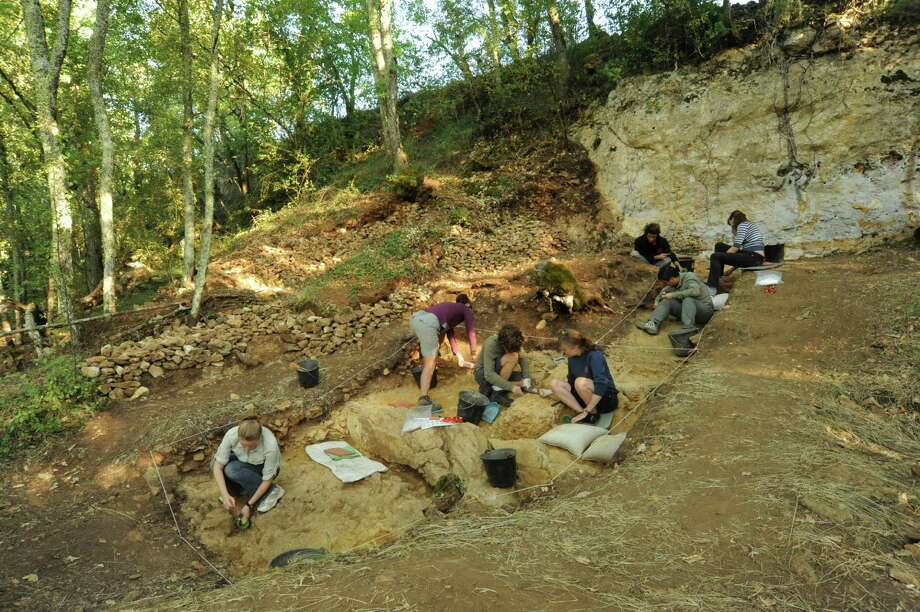 This undated photo provided Monday, Aug.12, 2013, by Abri Peyrony Project shows people working at the excavation of the Neanderthal site of Abri Peyrony, southwestern France, where bone tools known as lissoirs, were recently discovered. Researchers have found what they say are the first examples of specialized bone tools made by Neanderthals, a discovery that will add to debates about how advanced Neanderthals were and how much contact they had with modern humans. The discovery is being discussed by scientist, researchers and academics after the findings were published online Monday by the Proceedings of the National Academy of Sciences. Photo: AP