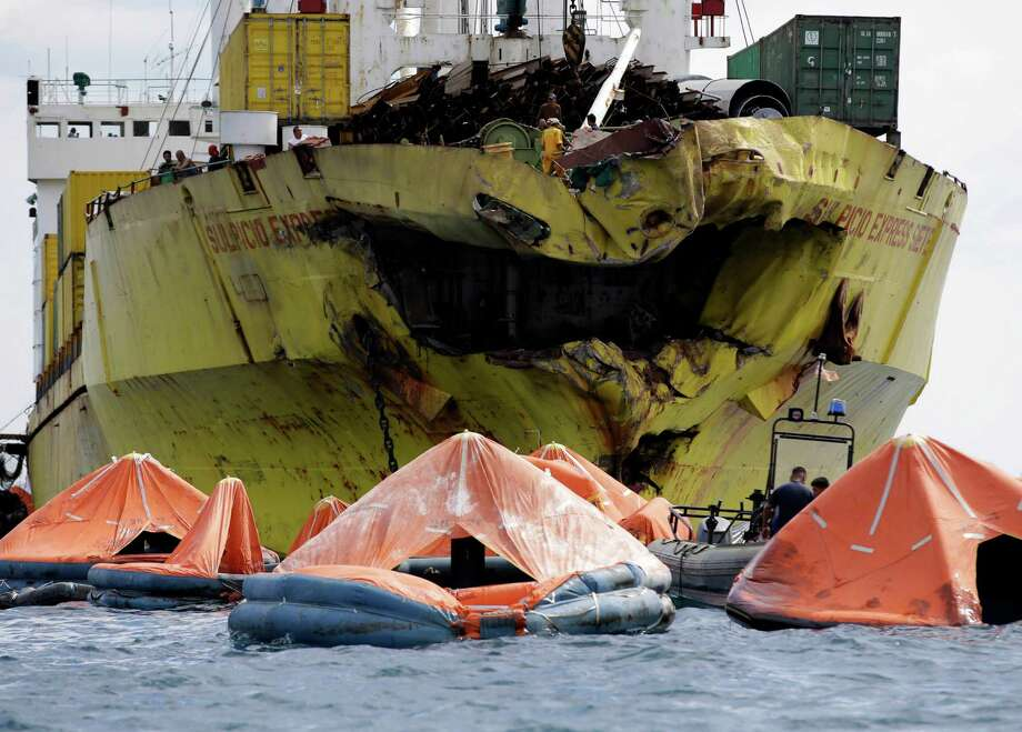 A cluster of life rafts floats near the cargo ship Sulpicio Express Siete Saturday Aug. 17, 2013, a day after it collided with a passenger ferry off the waters of Talisay city, Cebu province in central Philippines. Divers combed through a sunken ferry Saturday to retrieve the bodies of more than 200 people still missing from an overnight collision with a cargo vessel near the central Philippine port of Cebu that sent passengers jumping into the ocean and leaving many others trapped. At least 28 were confirmed dead and hundreds rescued. The captain of the ferry MV Thomas Aquinas, which was approaching the port late Friday, ordered the ship abandoned when it began listing and then sank just minutes after collision with the MV Sulpicio Express, coast guard deputy chief Rear Adm. Luis Tuason said. Photo: AP