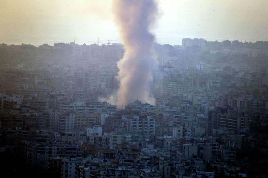 Smoke seen from Mount Lebanon rises from the site of a car bomb explosion in southern Beirut, Lebanon, Thursday, Aug. 15, 2013. The powerful car bomb ripped through a crowded southern Beirut neighborhood that is a stronghold of the militant group Hezbollah on Thursday, killing at least a dozen people and trapping dozens of others in burning cars and buildings in the latest apparent violence linked to the civil war in neighboring Syria, officials said. Photo: AP