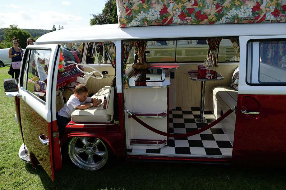 A boy plays in his VW campervan during the In Praise Of All Things VW At The Annual Festiva at Harewood Housel on August 18, 2013 in Leeds, Yorkshire. The annual VW festival in its 9th year attracts around 15,000 people over the weekend, ending with the winners car parade on Sunday. Photo: Nigel Roddis, Getty Images / 2013 Getty Images