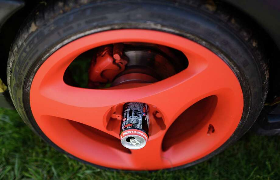 Coke cans are used in the centre of the wheels of a VW Golf during the In Praise Of All Things VW At The Annual Festiva at Harewood Housel on August 18, 2013 in Leeds, Yorkshire. The annual VW festival in its 9th year attracts around 15,000 people over the weekend, ending with the winners car parade on Sunday. Photo: Nigel Roddis, Getty Images / 2013 Getty Images