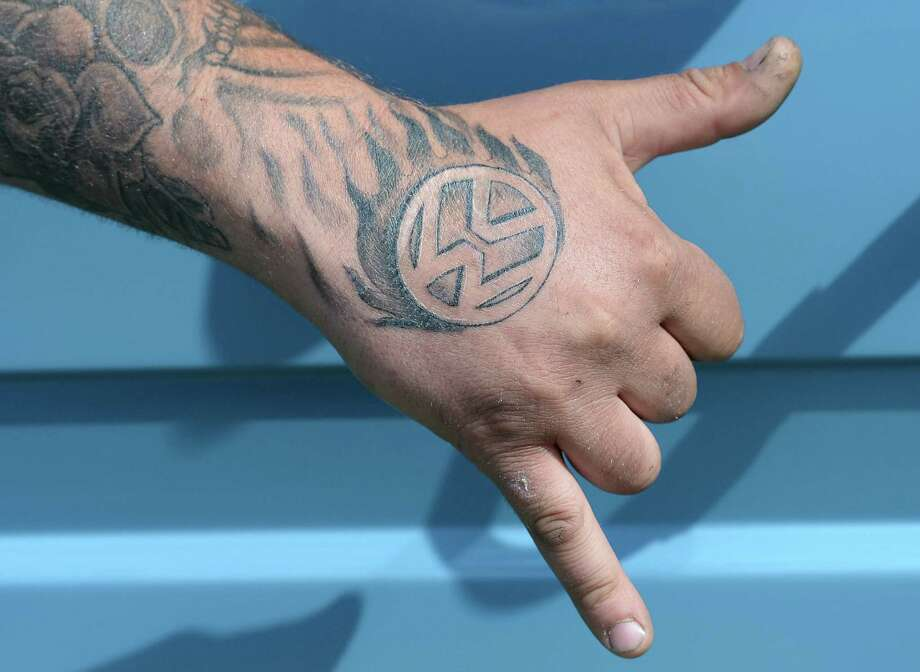 Lee Horton of Pontefract poses with his VW tattoo during the In Praise Of All Things VW At The Annual Festiva at Harewood Housel on August 18, 2013 in Leeds, Yorkshire. The annual VW festival in its 9th year attracts around 15,000 people over the weekend, ending with the winners car parade on Sunday. Photo: Nigel Roddis, Getty Images / 2013 Getty Images