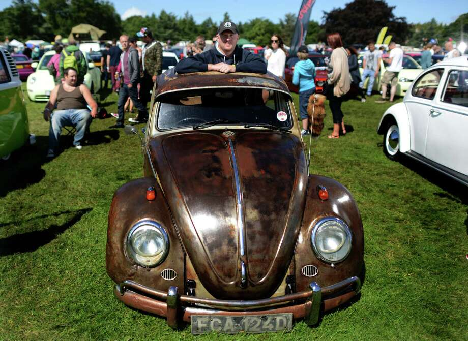 David Kooman with his 1966 VW Beetle during the In Praise Of All Things VW At The Annual Festiva at Harewood Housel on August 18, 2013 in Leeds, Yorkshire. The annual VW festival in its 9th year attracts around 15,000 people over the weekend, ending with the winners car parade on Sunday. Photo: Nigel Roddis, Getty Images / 2013 Getty Images