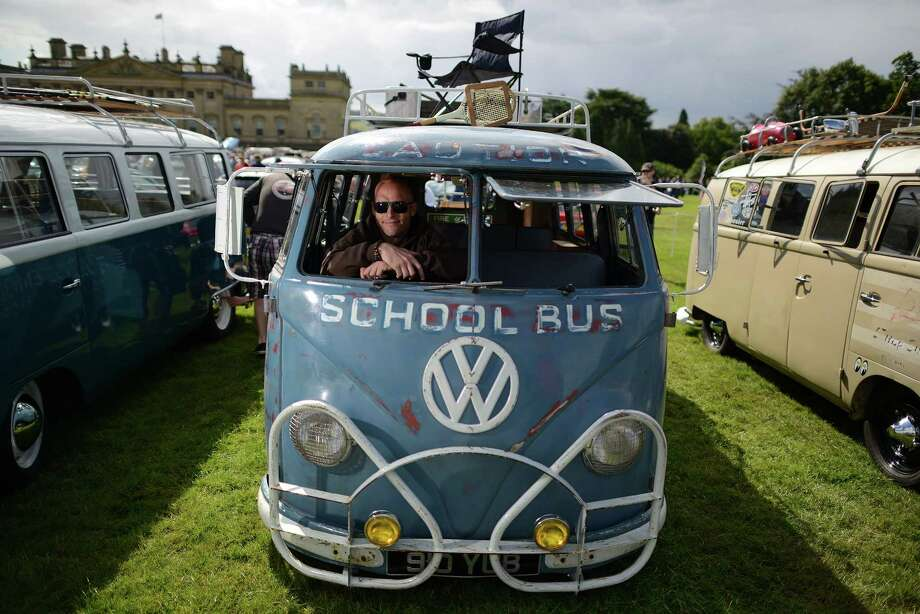Sooty Shuttleworth of Bingley sits in his 1957 VW splitscreen, a former Queenwood school bus in Australia  on display during the 'In Praise Of All Things VW At The Annual Festival' at Harewood House on August 18, 2013 in Leeds, England. The annual VW festival is in its 9th year attracting around 15,000 people over the weekend, ending with the winners car parade on Sunday. Photo: Nigel Roddis, Getty Images / 2013 Getty Images
