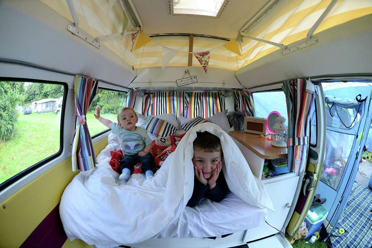 Charlie and Seth Rennie of Halifax play in their 1969 Silvia VW campervan during the 'In Praise Of All Things VW At The Annual Festival' at Harewood House on August 18, 2013 in Leeds, England. The annual VW festival is in its 9th year attracting around 15,000 people over the weekend, ending with the winners car parade on Sunday.