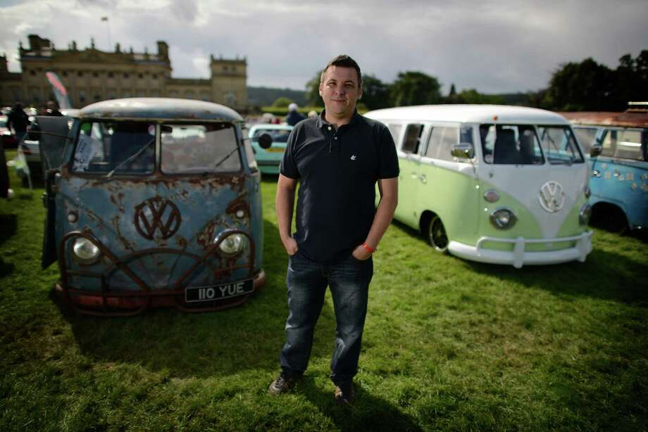 Sean Starbuck of Bradford with his 1967 VW splitsceen VW (L) on display during the 'In Praise Of All Things VW At The Annual Festival' at Harewood House on August 18, 2013 in Leeds, England. The annual VW festival is in its 9th year attracting around 15,000 people over the weekend, ending with the winners car parade on Sunday. Photo: Nigel Roddis, Getty Images / 2013 Getty Images