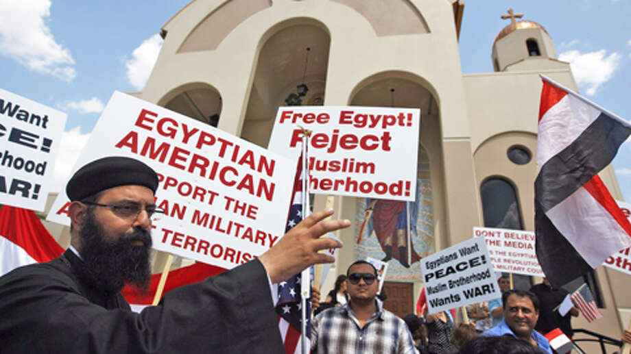 Houston's Coptic community protests Sunday against the Muslim Brotherhood and in support of Egypt's military. The group gathered at Saint Mary & Archangel Michael Coptic Orthodox Church on Lakeview Haven Drive in the Copperfield area near Texas 6. Photo: Johnny Hanson, Houston Chronicle