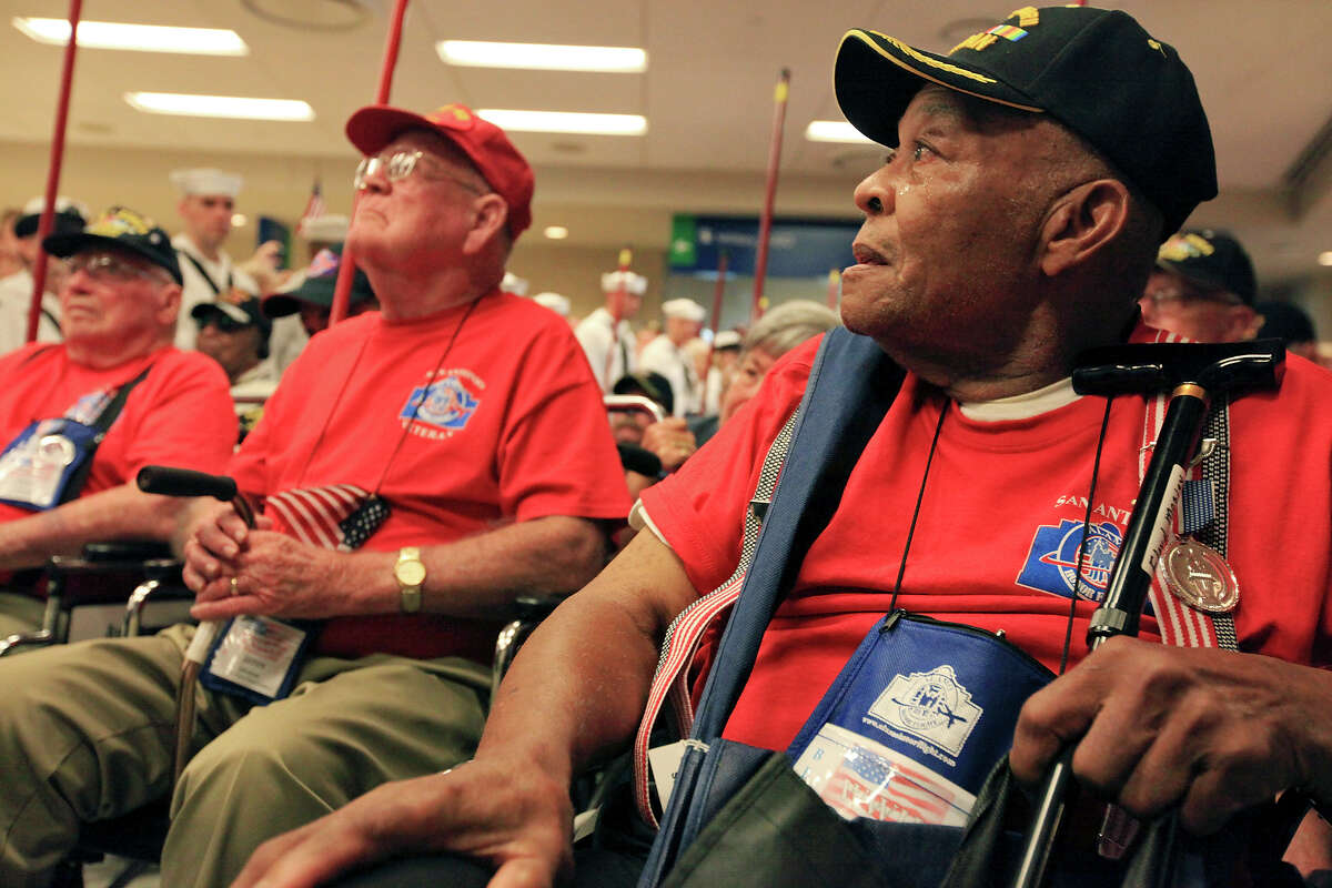 World War II Navy veteran Floyd Mosley, 88, (right) cries as he and other World War II veterans are greeted at the San Antonio International Airport after taking part in the last Alamo Honor Flight Sunday Aug. 18, 2013. The Alamo Honor Flight is a nonprofit that gives World War II veterans an all expense paid trip to Washington D.C.