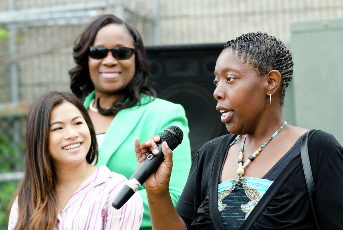 Educator Virginia Hudson-Johnson introduces herself during a block party held at Dunbar School in Bridgeport on Sunday, Aug. 18, 2013.