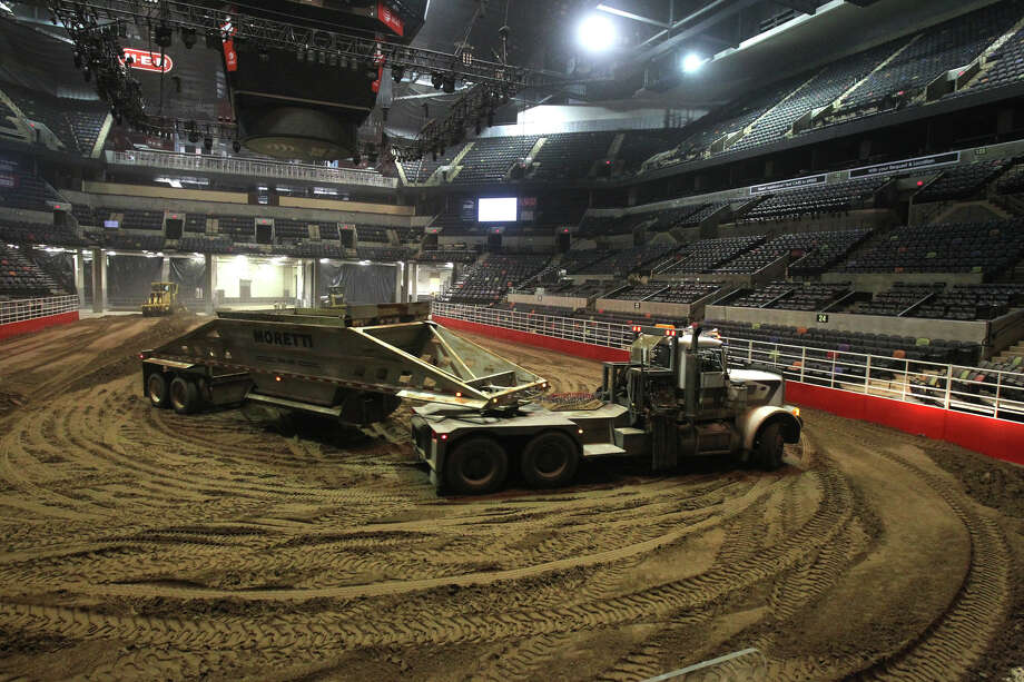 To prepare the AT&T Center for the San Antonio Stock Show & Rodeo, the same 2,160 tons of dirt is trucked in to cover the floor every year. The rodeo has been reusing the same dirt since 1988. (Don't worry, they sift it every other year ... eeeewwww!)Related Slideshow: Stock Show & Rodeo prep is dirty work Photo: JOHN DAVENPORT, San Antonio Express-News / SAN ANTONIO EXPRESS-NEWS (Photo can be sold to the public)