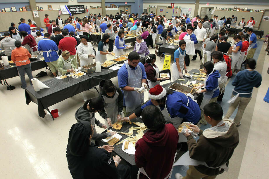 Lanier High School set the Guinness World Record for most tamales made in 12 hours during a massive tamalada on Dec. 6, 2011. A group of 1,300 students and volunteers worked together to make 17,232 tamales weighing a combined 2,420.9 pounds. Guinness certified the record the following April. Photo: KIN MAN HUI, San Antonio Express-News / SAN ANTONIO EXPRESS-NEWS